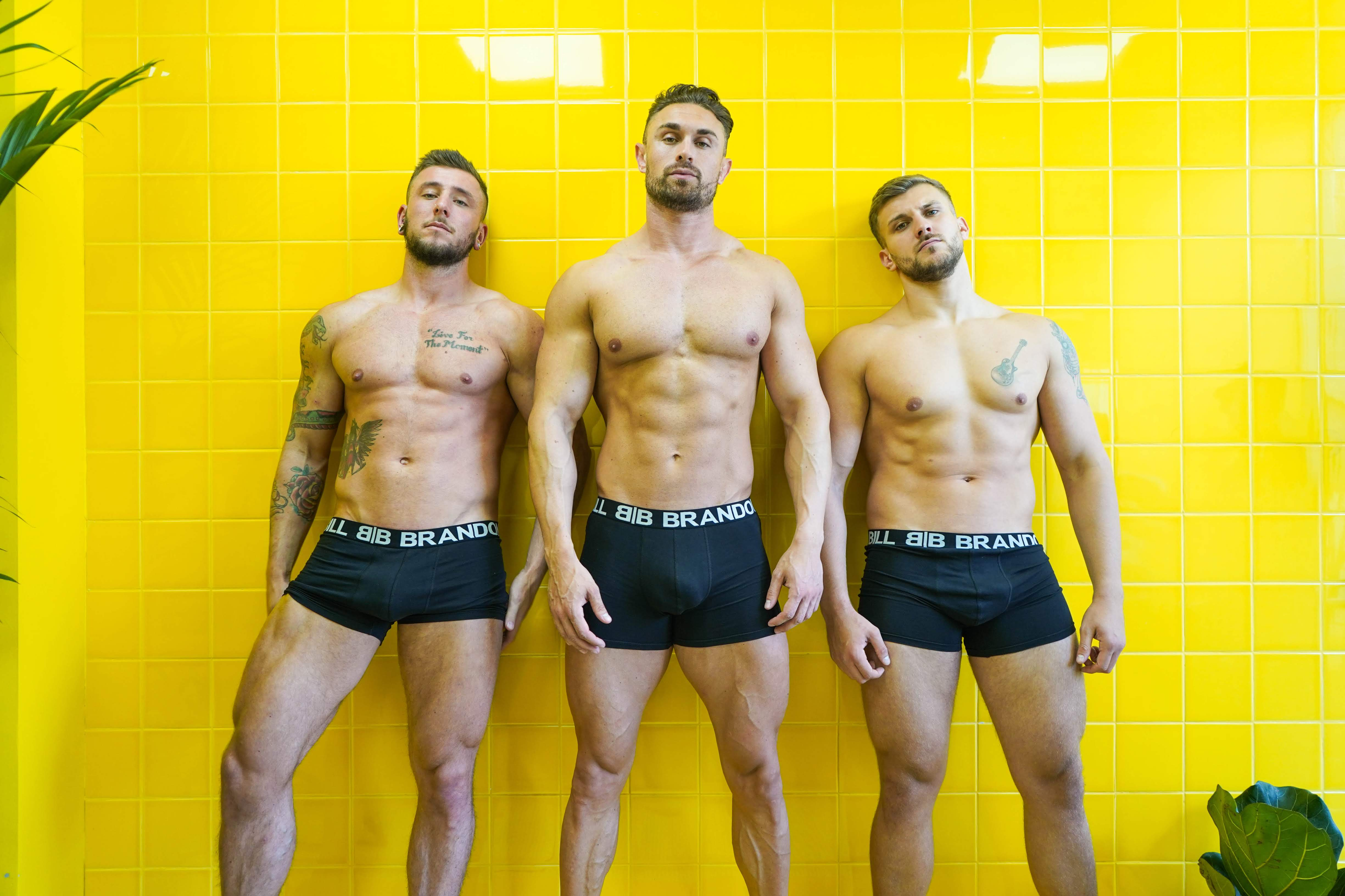 A lifestyle image showing Bill and Brandon Men's underwear - Black boxer trunks.