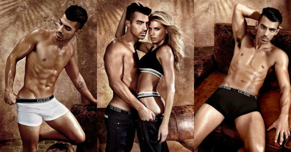A picture taken from the 2017 Guess men's underwear campaign. The picture shows Joe Jonas and Charlotte McKinney modelling.
