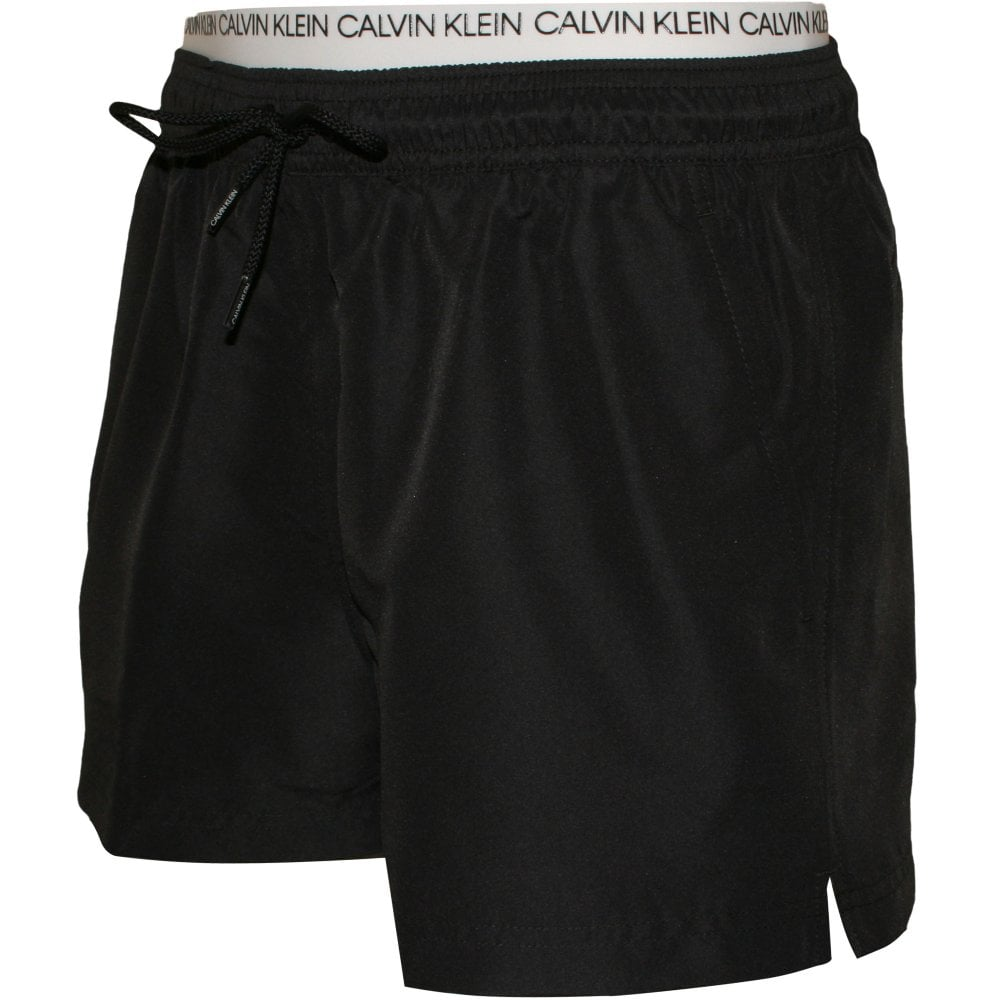 e418be88be Calvin Klein Double-Waistband Athletic-Cut Swim Shorts, Black | UnderU