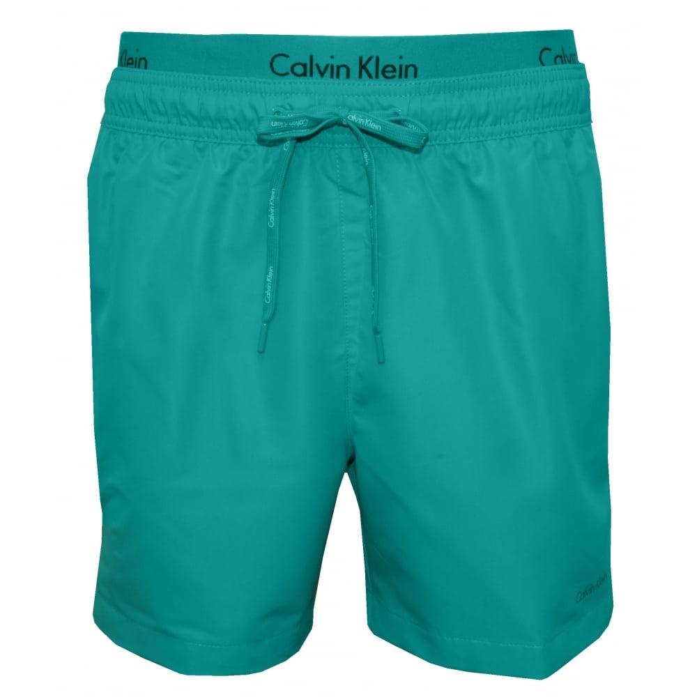 a0cff594f4 Calvin Klein Double Waistband Swim Shorts, Ceramic Blue | UnderU