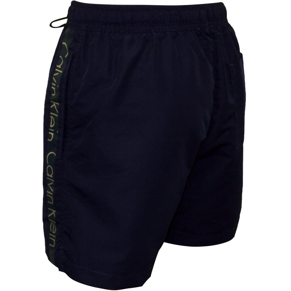 530cbc920f Calvin Klein Logo Tape Swim Shorts, Navy | CK swim shorts | UnderU